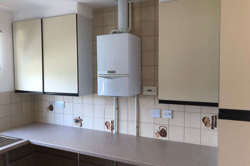boiler installation in kitchen located conveniently and safely
